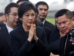 泰国前美女总理英拉受审大变样[图]